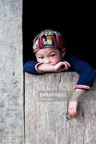 young child from the red dao tribe - hugh sitton stock pictures, royalty-free photos & images