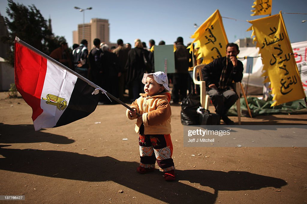 A young child holds an Egyptian flag in Tahrir Square on January 26, 2012 in Cairo, Egypt. Tens of thousands of Egyptian people gathered yesterday to celebrate the anniversary of the start of the uprising which ended President Hosni Mubaraks rule.
