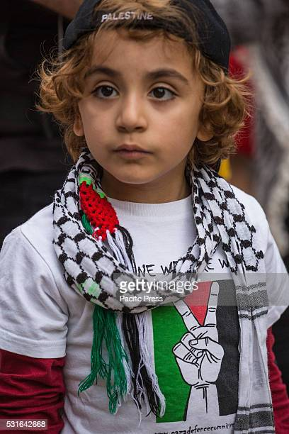 HALL SYDNEY NSW AUSTRALIA A young child in 'Keffiyeh' shows his support at the demonstration Hundred of demonstrators rallied and marched in Sydney...