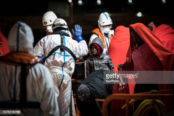 A young child is getting ready to leave the Spanish Marotome vessel to be transferred to the Red Cross' Care Unit at eth Malaga's harbour on 22...