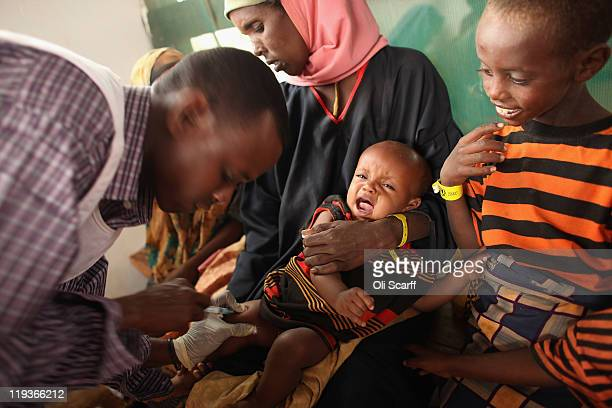 A young child is given a vaccine by Medecins Sans Frontieres in the Dagahaley refugee camp which makes up part of the giant Dadaab refugee settlement...