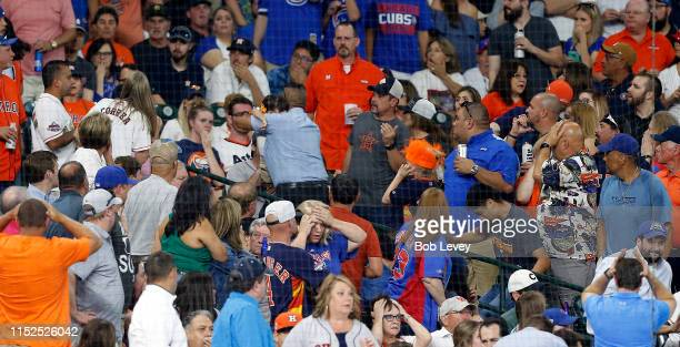 A young child is rushed from the stands after being injured by a hard foul ball off the bat of Albert Almora Jr #5 of the Chicago Cubs in the fourth...