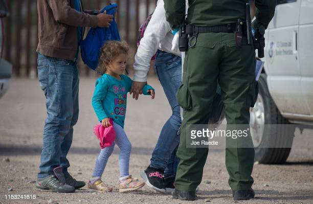 A young child is seen as she along with other migrants are processed by Border Patrol agents after being detained when they crossed illegally into...