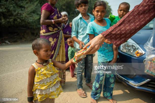 Young child is seen getting a packet of biscuits during Navaratri one of the prominent Hindu festivals. Charity has great significance in Hindu...