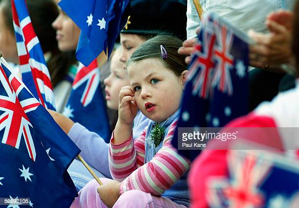PA young child looks on during the parade for Anzac Day on April 25 2005 in Perth Australia Australians and New Zealanders are today commemorating...