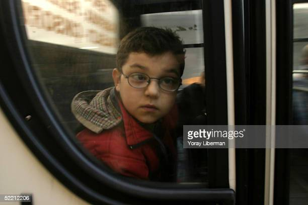A young child looks out of the window of a bus in the city center December 4 2004 in Gaziantep Turkey
