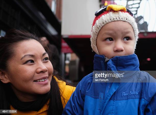 A young child looks watches a dragon dance performance as the Chinese community come together to welcome in the Chinese New Year on February 22 2015...