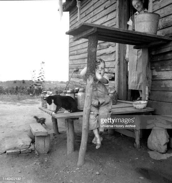Young Child of Sharecropper on Rural Porch, Chesnee, South Carolina, USA, Dorothea Lange, Farm Security Administration, June 1937.