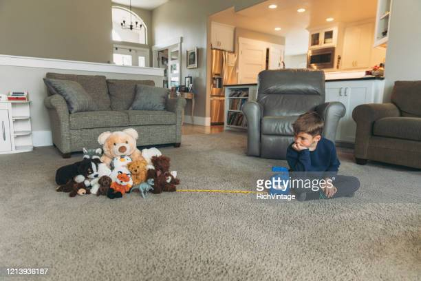 young child practicing proper social distancing - good; times bad times stock pictures, royalty-free photos & images