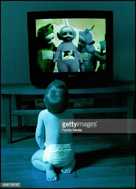 A young child sits watching the teletubbies on television 28 December 2000 AFR Picture by LOUISE KENNERLEY