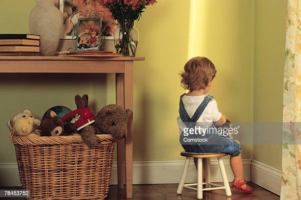 young child sitting in corner as punishment - penalty stock pictures, royalty-free photos & images