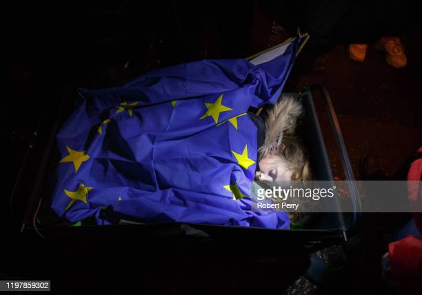 Young child sleeps in a makeshift bed as Missing EU Already hold candlelight vigil outside the Scottish Parliament at Holyrood as the UK leaves the...