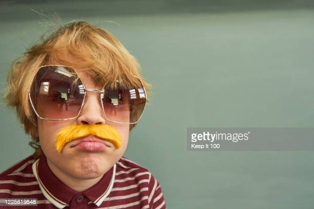 young child styled as a retro 1970s adult - sunglasses stock pictures, royalty-free photos & images