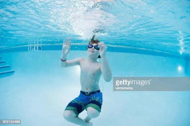 Young child swimming in a pool in Florida on a beautiful night