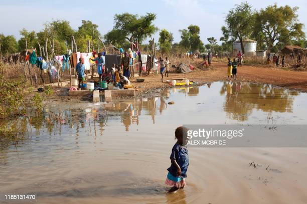 Young child wades through the remaining flood waters in Yusuf Batir refugee camp in Maban, South Sudan on November 25, 2019. - Large areas of eastern...