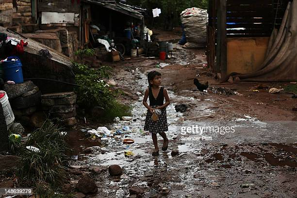 Young child walks home in an area known for heavy drug dealing on July 18, 2012 in Tegucigalpa, Honduras. Honduras now has the highest per capita...
