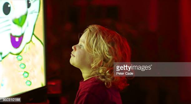young child watching television - television stock pictures, royalty-free photos & images