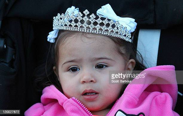 A young child wearing a tiara on her head arrives to attend a child beauty pageant at Northcote Town Hall on July 29 2011 in Melbourne Australia The...