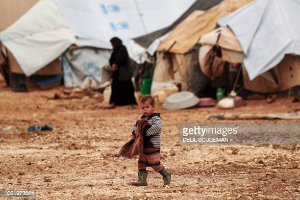 A young child who was displaced with families from Deir Ezzor and its surroundings walks at a camp for displaced people near the town of alArishah in...