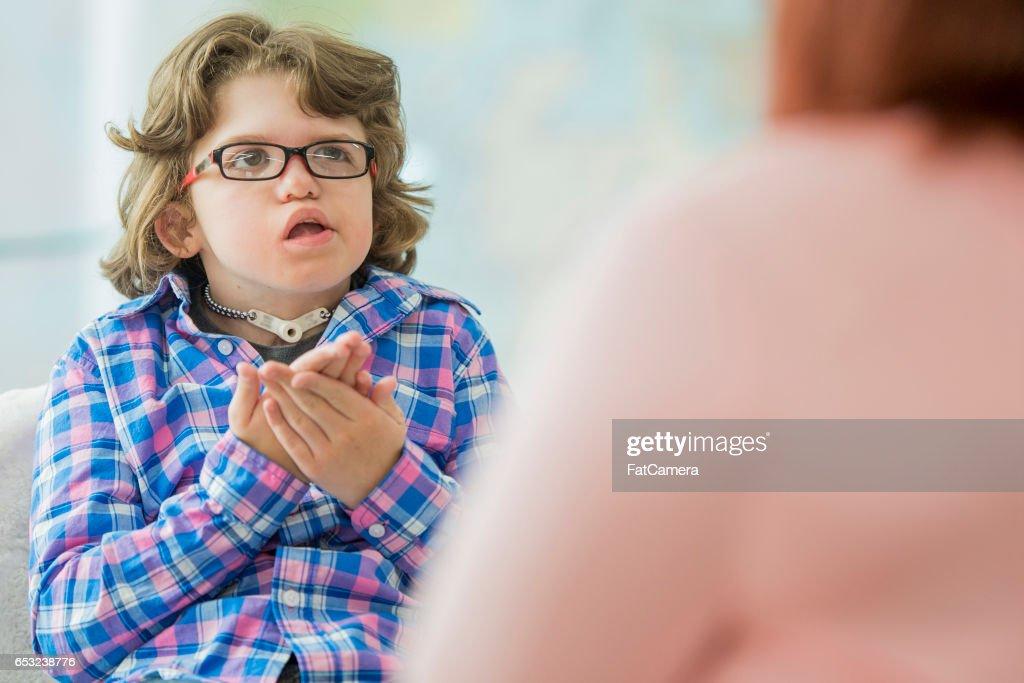 Jeune enfant ayant une déficience : Photo