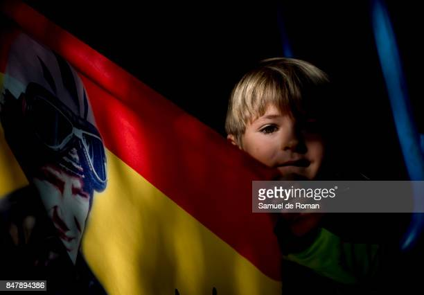 A young child with a flag of Angel Nieto during the Funeral Tribute For Angel Nieto in Madrid on September 16 2017 in Madrid Spain