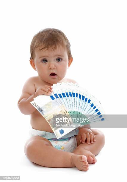 young child with banknotes, symbolic picture for child benefits - charity benefit fotografías e imágenes de stock