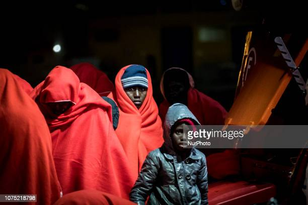 A young child with being transferrred to the Care Unit at the Malaga port on 22 December 2018 in Malaga Spain 120 migrants were recued from the...