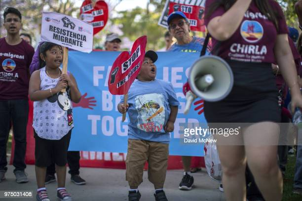 Young children alongside adults protest the Trump administration policy of removing children from parents arrested for illegally crossing the...