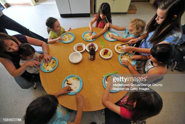 Scott Varley Young children at Temple Beth El make charoset a traditional chunky paste of made of fruits and nuts that is served during a Passover...