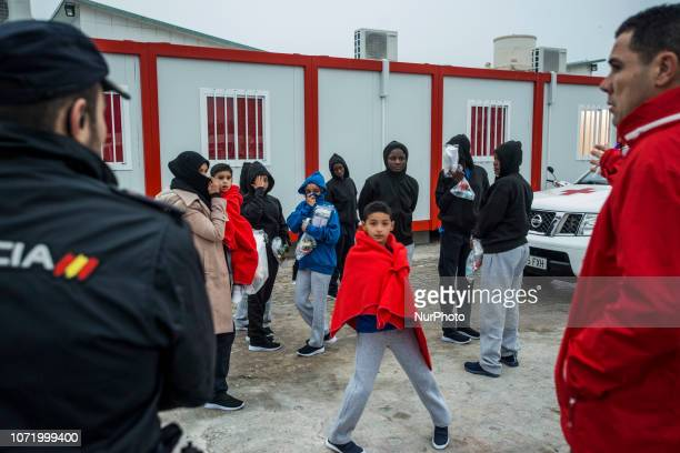 Young children being transferred to a center On 7 December 2018 in Malaga Spain The Spanish Maritime vessel the quotSAR Masteleroquot rescued 130...