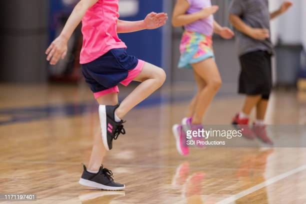 young children do cardio exercises - physical education stock pictures, royalty-free photos & images