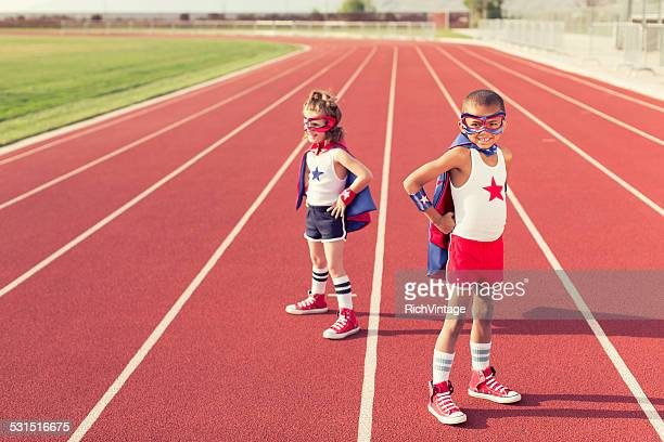 Young Children dressed as Superheroes on Running Track