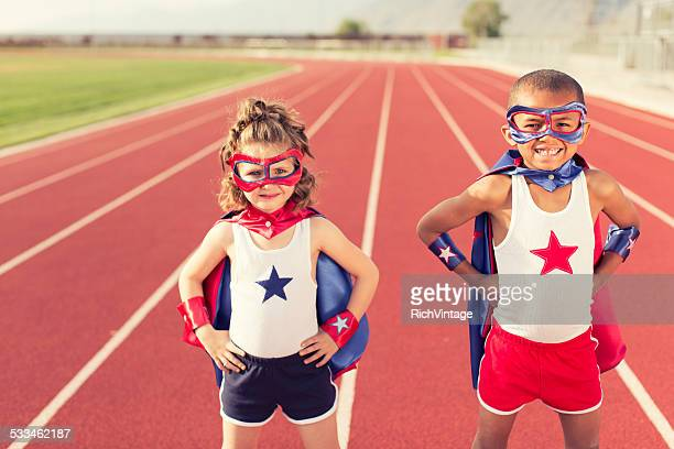 Young Children dressed as Superheroes Standing on Track