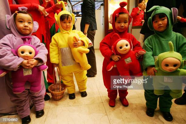 Young children dressed as Teletubbies babies play in a shopping mall on December 2 2006 in Wuhan of Hubei Province China Western traditions such as...
