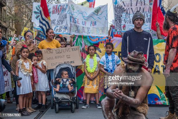 Young children dressed in traditional dress representing the Pacific Island get ready to march on September 20 2019 in Melbourne Australia Rallies...