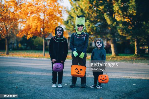 young children dressed up for halloween - frankenstein stock pictures, royalty-free photos & images