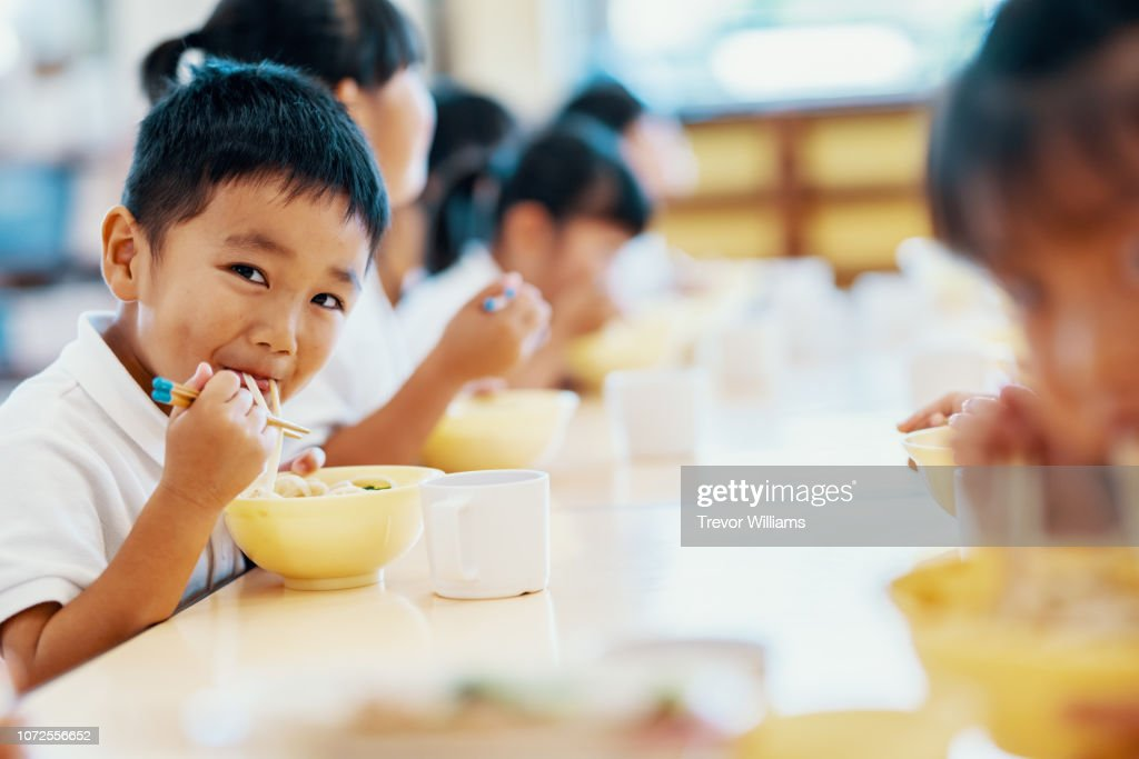 Young children eating their school lunch at preschool : Stock Photo