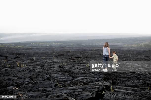young children exploring a lava field - ハワイ火山国立公園 ストックフォトと画像