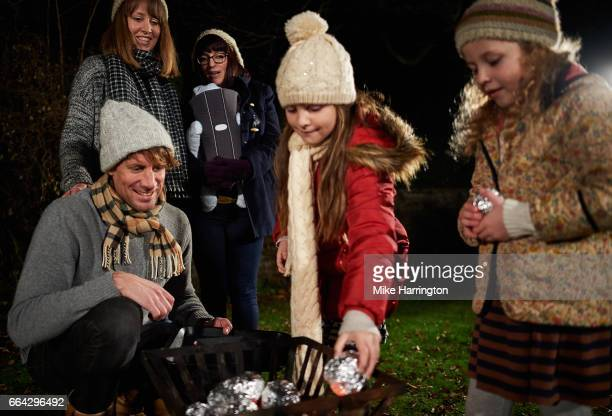 Young children learning how to cook using bonfire