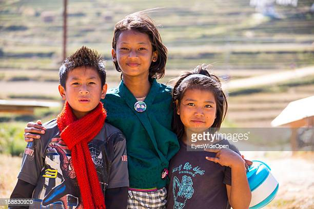 Young children of the village Chimi Lhakhang in the Punakha Valley with its temple monastery is renowned for its fertility blessings phallus or penis...