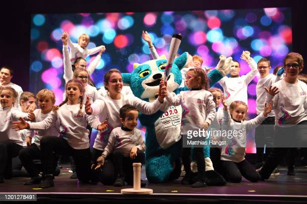 Young children perform a choreography on stage with the Lausanne 2020 mascot, Yodli during the closing ceremony on day 13 of the Lausanne 2020 Winter...