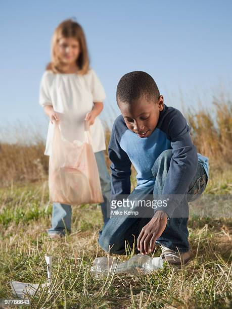 Young children picking up litter