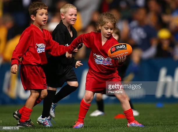 Young children play Auskick at the half time break during the round five AFL match between the West Coast Eagles and the Port Power at Patersons...