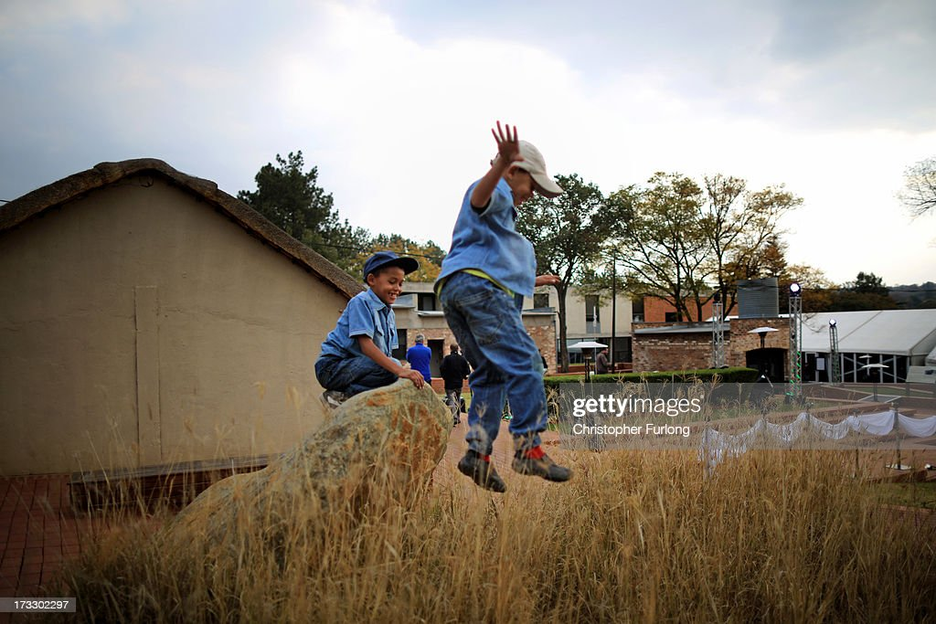 Young children play during anniversary celebrations at Liliesleaf Farm; the apartheid-era hideout for Nelson Mandela and freedom fighters in Johannesburg, on July 11, 2013 in Rivonia, South Africa. It is 50 years since the hideout was raided by police on July 11, 1963. The farm was the secret nerve centre for the Umkhonto we Sizwe, the military wing of the ANC and the Congress Alliance. Police interrupted a meeting of Operation Mayibuye, a plan to overthrow the Apartheid government. The raid by police led to the arrest of Nelson Mandela, Walter Sisulu, Ahmed Kathrada, Govan Mbeki and Denis Goldberg, who were convicted through the infamous Rivonia Trial and most were sentenced to life imprisonment on Robben Island.