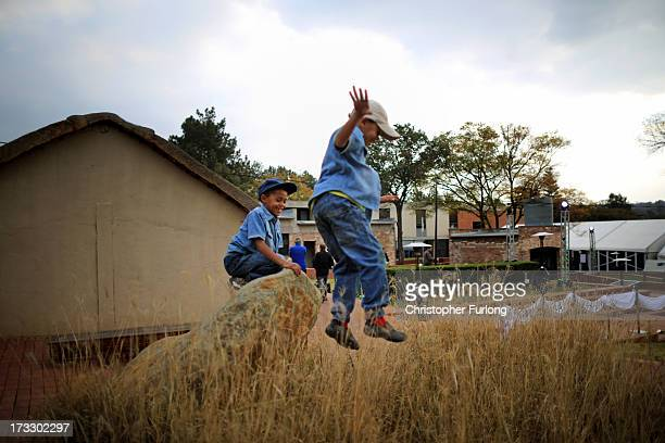 Young children play during anniversary celebrations at Liliesleaf Farm the apartheidera hideout for Nelson Mandela and freedom fighters in...
