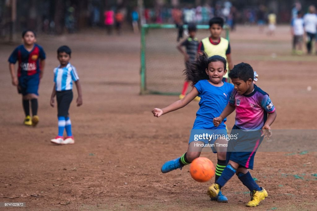 Young children play football ahead of FIFA World Cup which is going to be held in Russia, at Shivaji Park, Dadar, on June 13, 2018 in Mumbai, India.