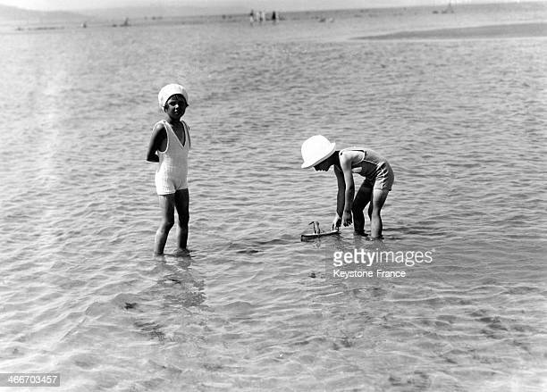 Young children playing on the beach in July 1929 in Deauville France