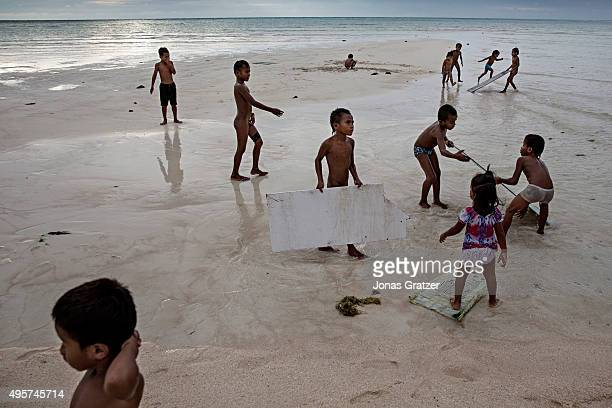 Young children playing on the beach on the island of Tarawa the capital of the Republic of Kiribati The people of Kiribati are under pressure to...