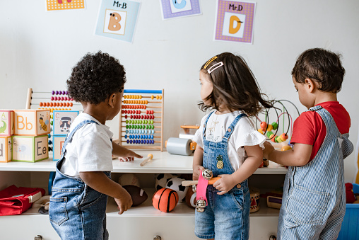 Young children playing with educational toys 1125881895