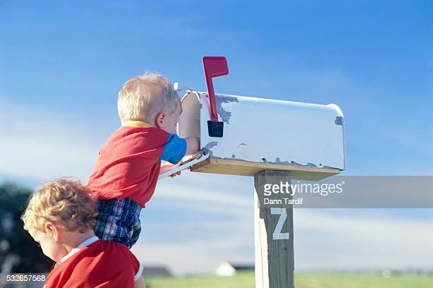 Young Children Reaching into Mailbox